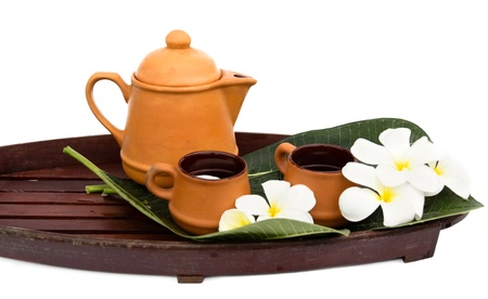 Asian tea set with flower.