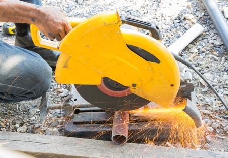 Welder works sparkle cutting metal
