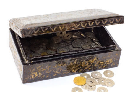 Wooden casket full of ancient coins thai  photo
