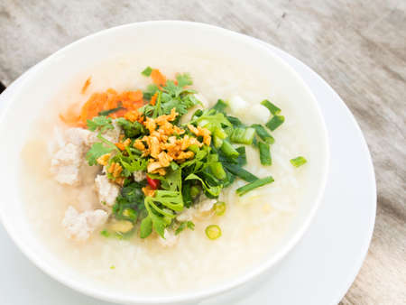 Traditional porridge rice gruel in bowl.