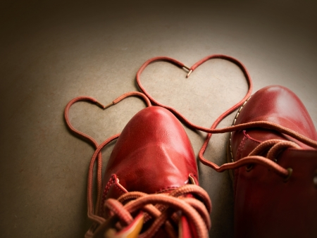 athletic symbol: Red shoes with Lovely Heart. Stock Photo
