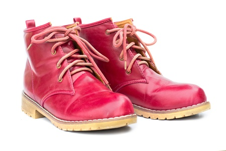 untied: Red boots and untied shoelaces on the white background. Stock Photo