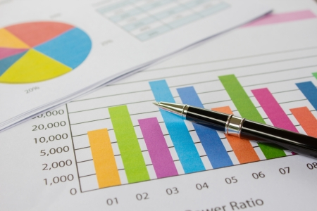 document management: Graphs, charts and pen, business on table.