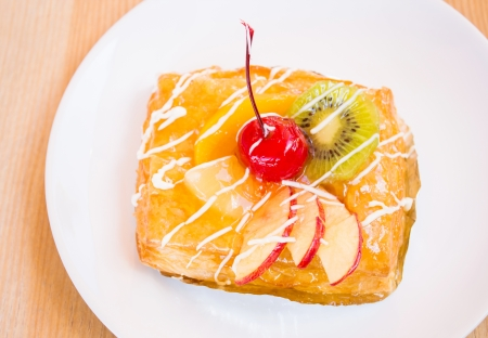 pastry pie with fresh fruit on dish. Stock Photo