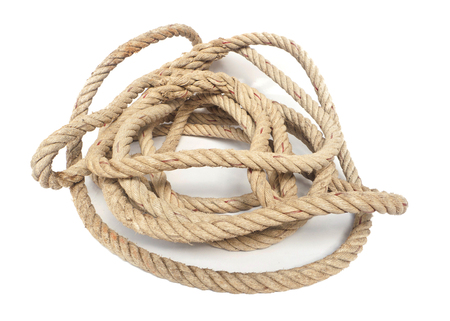 coil of old rope on white .