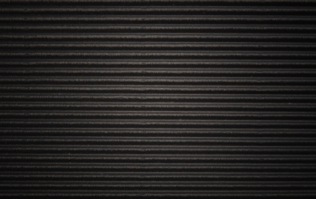 Black corrugated cardboard texture or background. Stock Photo
