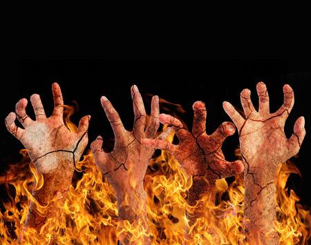 infierno: Quemar la mano del infierno. Foto de archivo