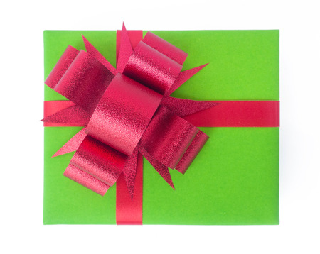 green gift with a red ribbon and a bow