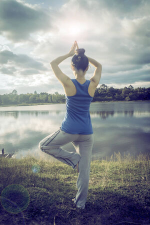 serenity and yoga practicing at sunset