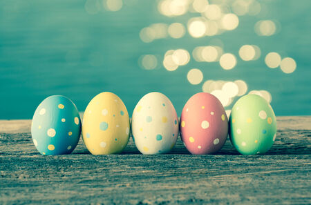 Easter eggs on old wooden background photo