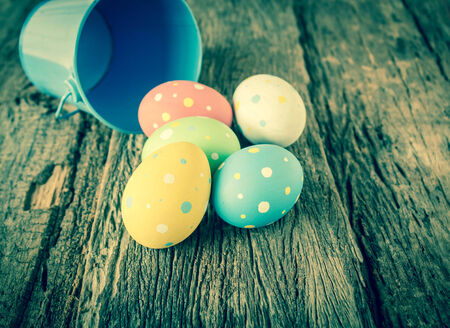 Easter eggs on old wooden background