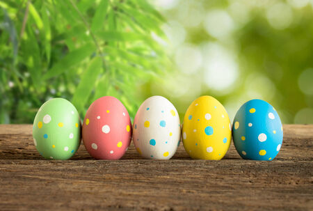 Easter eggs on old wooden with bokeh light. photo