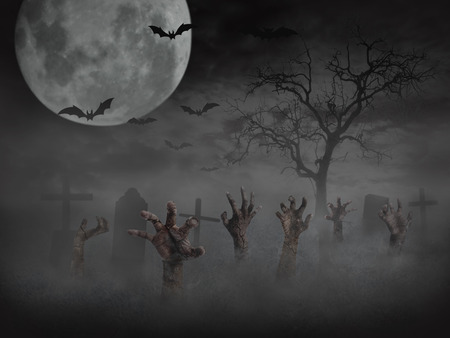 Zombie hand rising out of the ground,Halloween background. Stock Photo