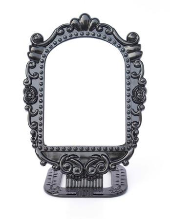 Vintage mirror on white background. photo