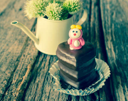 Chocolate cupcakes with heart shaped on wood
