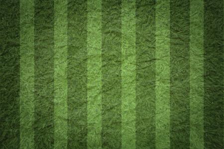 Soccer ball on green stadium, arena in night illuminated bright spotlights. photo