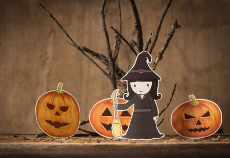 Little witch with halloween pumpkin. photo