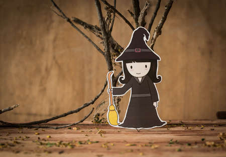 Little witch with halloween background.