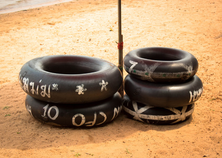 black ring on the beach ,Tropical beach. Stock Photo