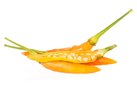 hot peppers: Three orange hot peppers over white Stock Photo