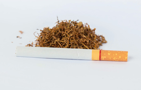 vices: Cigarette and tobacco on a white background Stock Photo