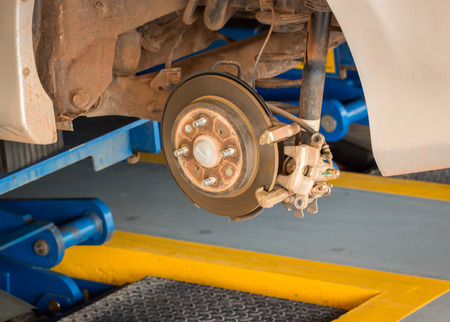 auto hoist: Changing wheel on a car Stock Photo