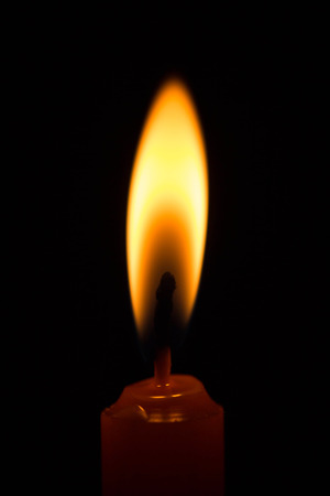flame background: Burning Candle on the black background