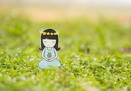 one girl only: Young woman meditating in nature. Stock Photo