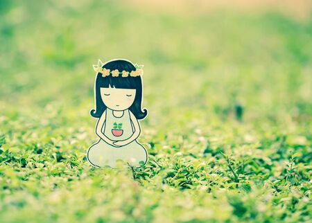 breathing exercise: Young woman meditating in nature. Stock Photo