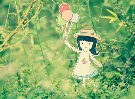 nature woman: Young woman holding colorful balloons in the summer.