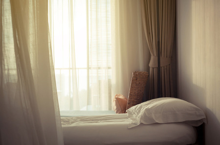 messed: White themed bed sheets and pillow messed up in the morning Stock Photo