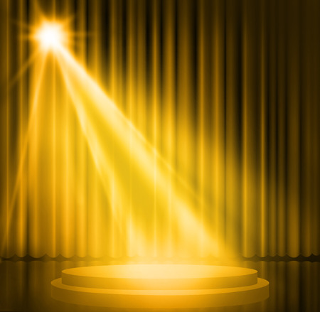 Gold curtains on theater with spotlight.
