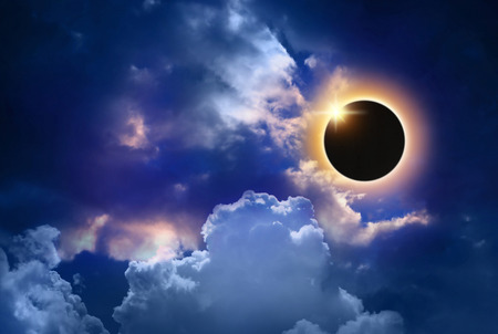 solar eclipse: imaginary solar eclipse space with clouds.
