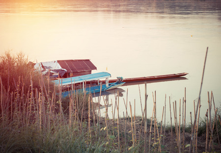 mekong river: House and boat on the Mekong river at Thailand. Stock Photo