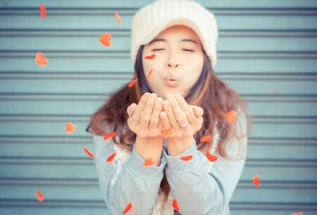 multiple ethnicities: Lovely girl playing with little hearts,valentines day background