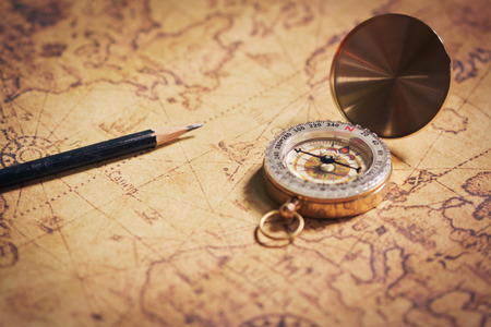 map pencil: compass on vintage map with pencil.