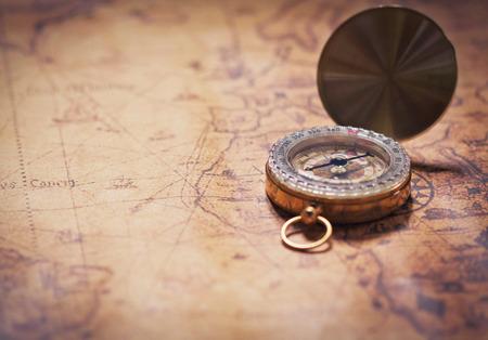 compass on vintage map with pencil. Фото со стока - 44400761