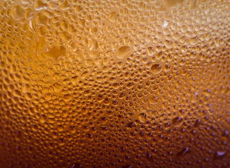 carbonation: glass of cola with water drops on glass