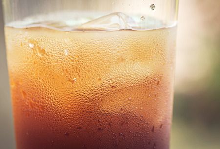 carbonation: glass of cola with ice cubes. Stock Photo