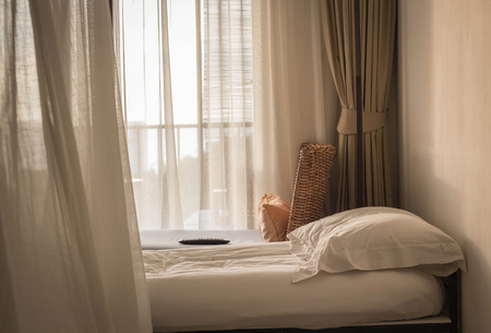 messed up: White themed bed sheets and pillow messed up in the morning Stock Photo