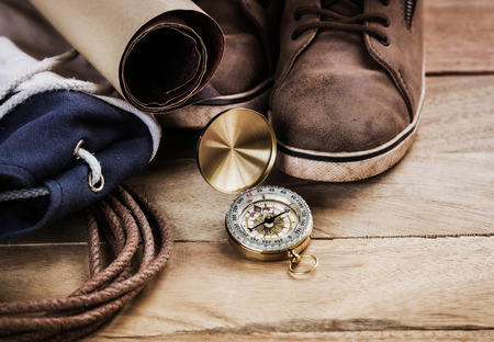 compass: compass on vintage map with accessory to the Adventure.