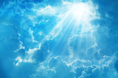 blue sky with sun and beautiful clouds,on the heaven. Standard-Bild