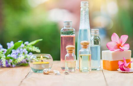 merchandise: Spa treatment with scented candles and soap on wood. Stock Photo
