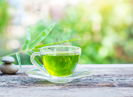 green drink: cups of green tea on wooden table