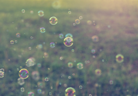 soap bubbles: Rainbow bubbles from the bubble blower,vintage background.