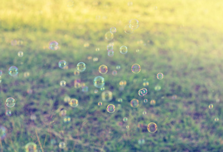 Rainbow bubbles from the bubble blower,vintage background.