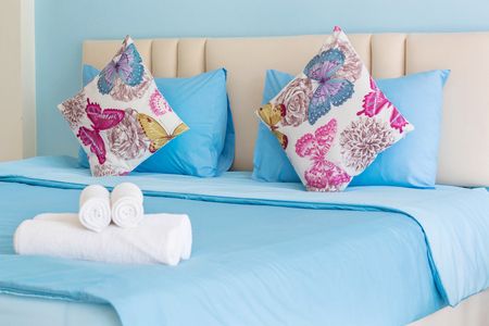 Decorative pillow with white towel in bed,Room service,Thailand. Stock Photo