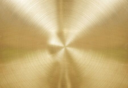 industrial sheet iron: Gold brushed metal plate with reflections in circular.