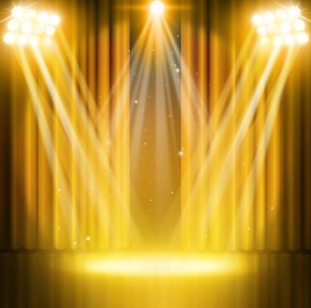 Złote kurtyny teatru z reflektorów.