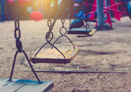 chain swing ride: Empty chain swing in playground.